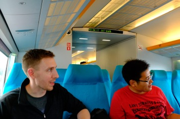 Andrew and Phil looking out at the landscape as we speed from the Shanghai Pudong airport into the heart of Shanghai. We were going about 190mph at the time, but the train reached speeds of ~250mph before leveling off.