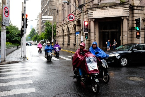 ...and riders seem to always be prepared for rain. The ponchos and umbrellas during showers were great for street photography!